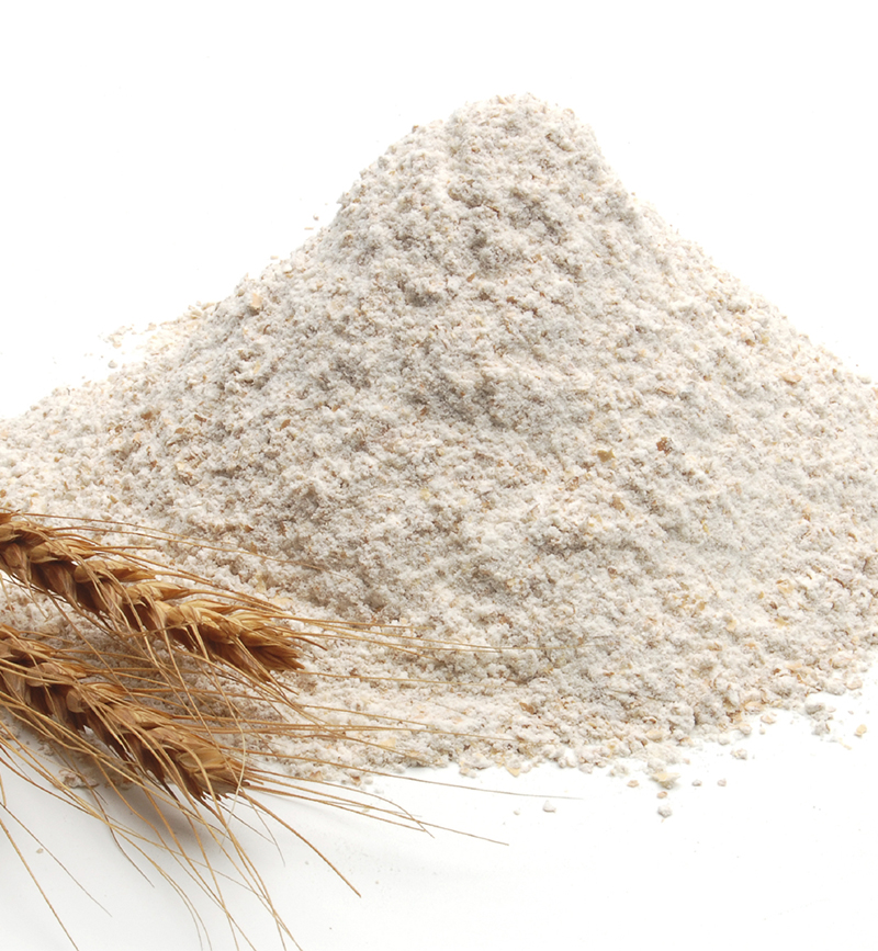 Whole flour and wheatears on white background